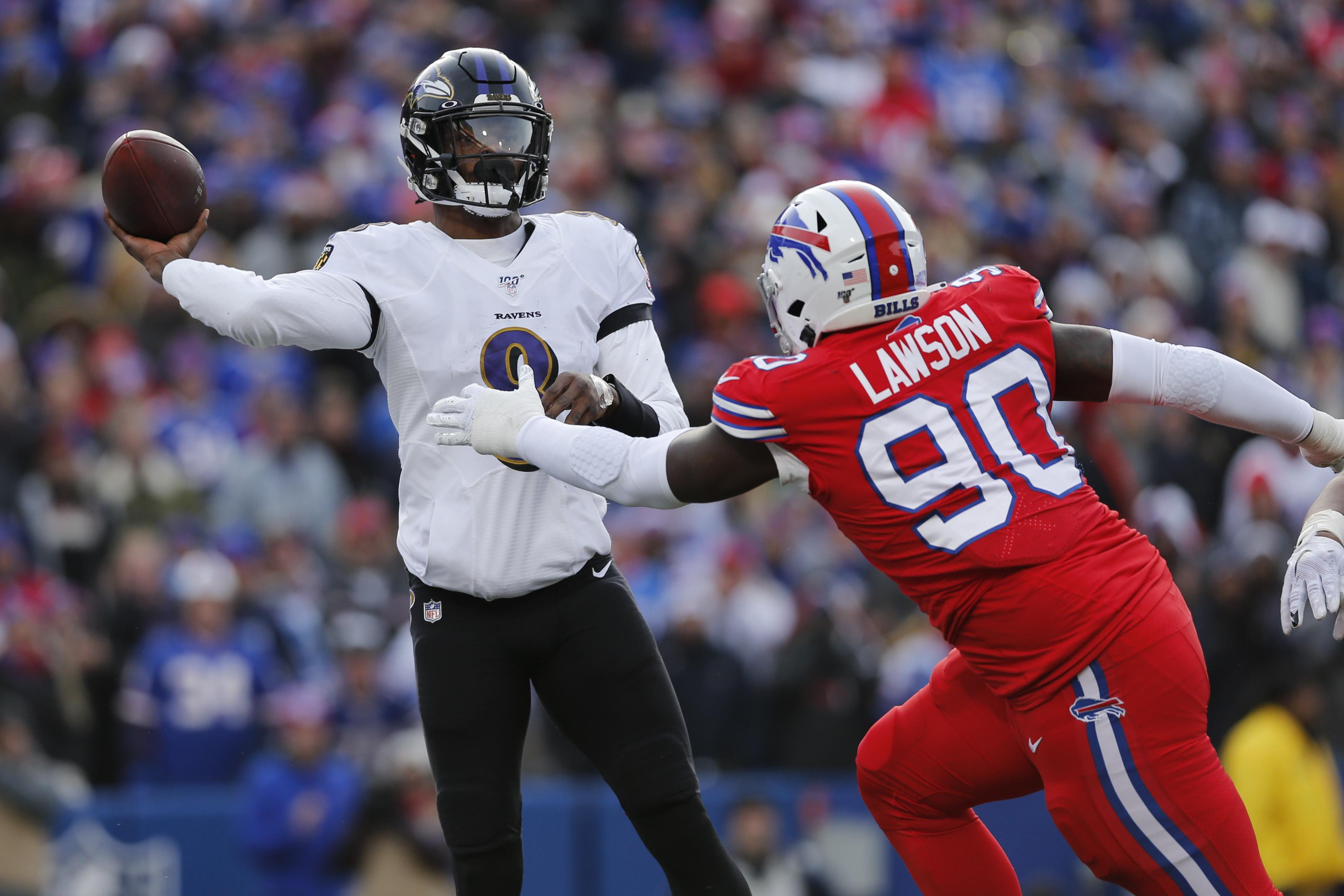 Ravens Hold Off Bills Clinch Afc Playoff Berth The Boston Globe