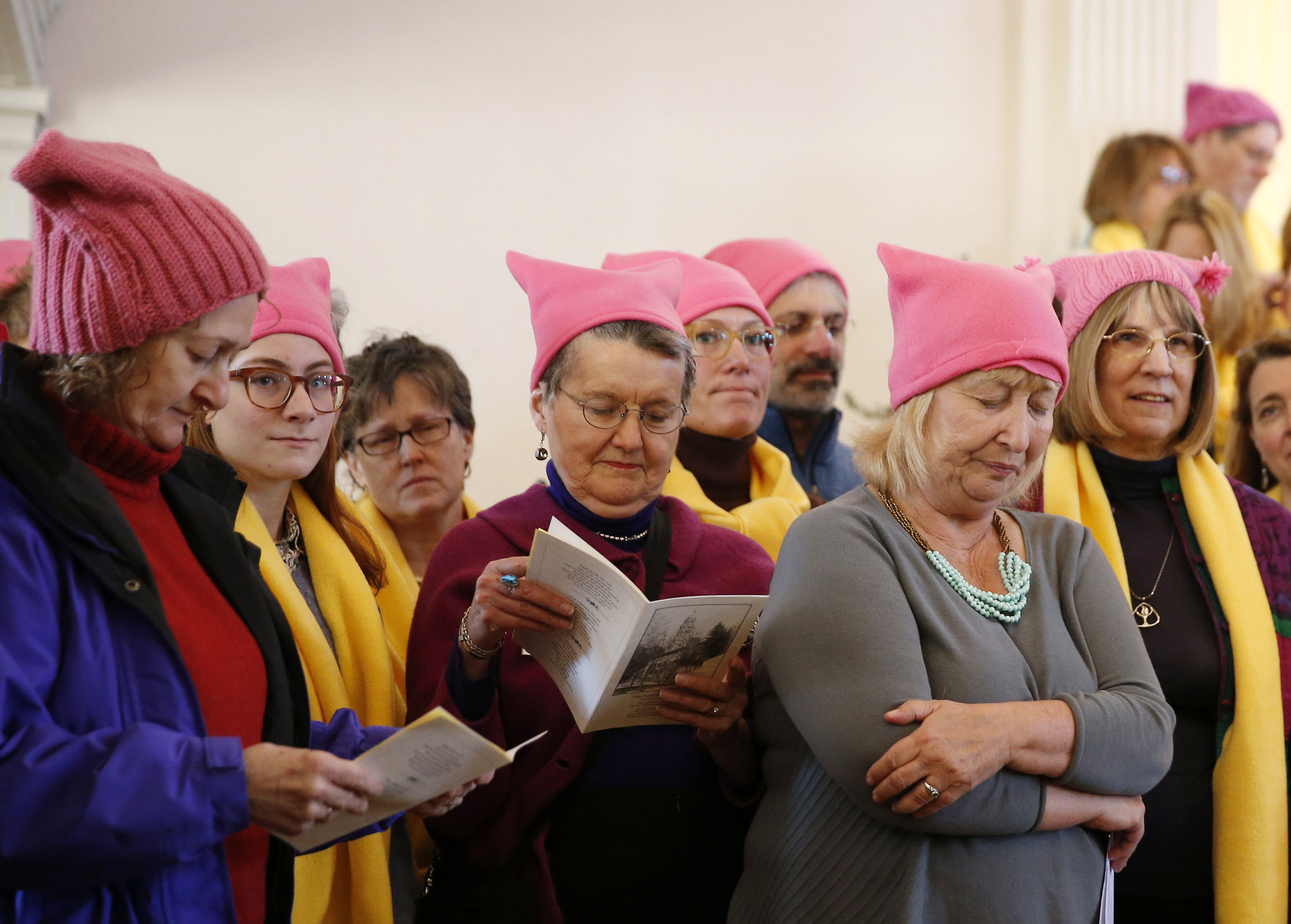 cac28ccc0a9fc Knitting protesters grab back at Trump with pink cat hats - The Boston Globe