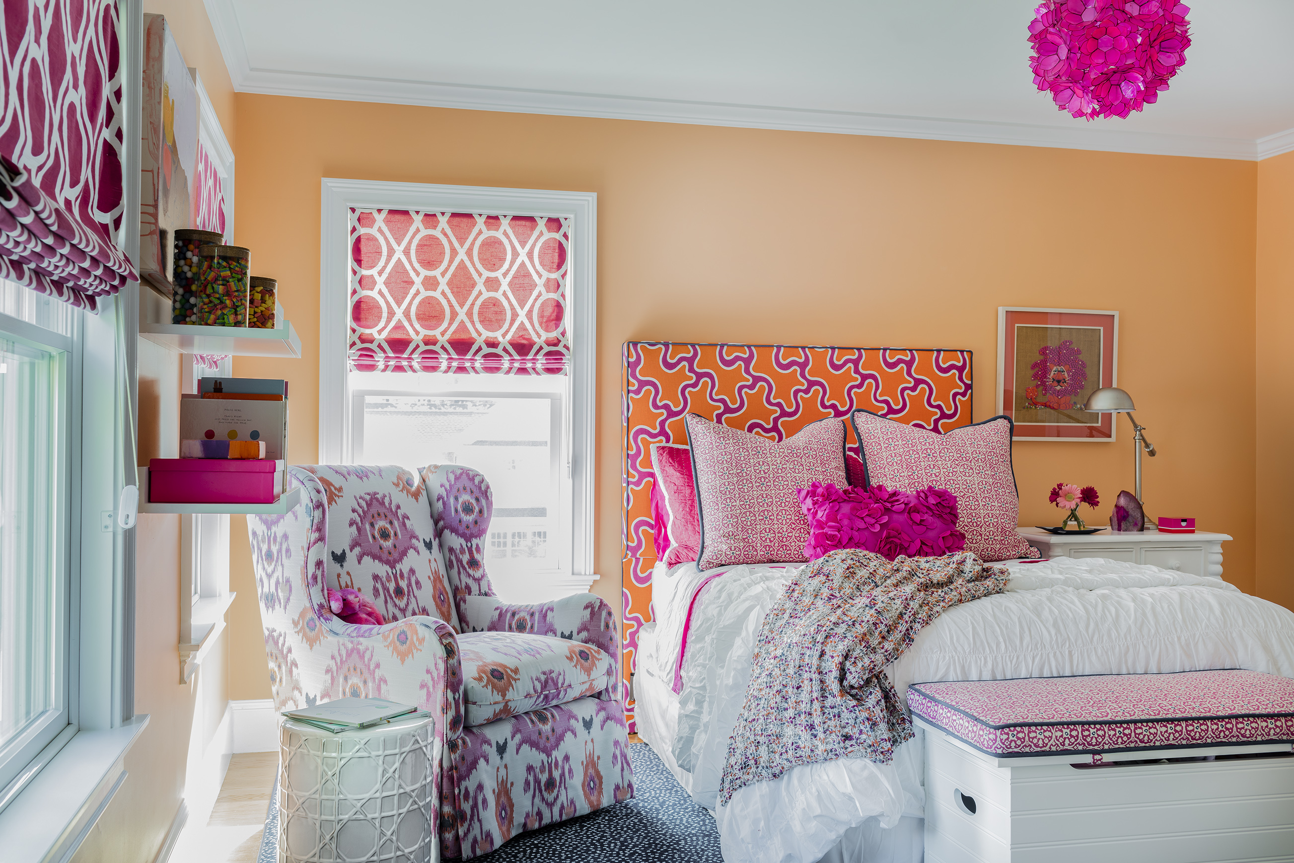 Peach walls and pink accents brighten up a girl\'s bedroom ...