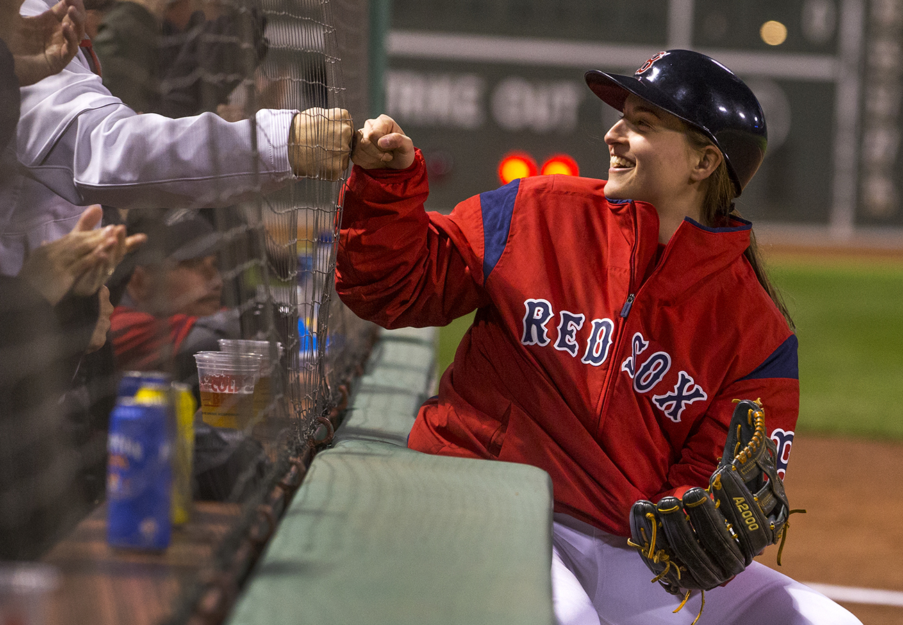 What is a hockey player doing on the field during Red Sox games at Fenway Park?